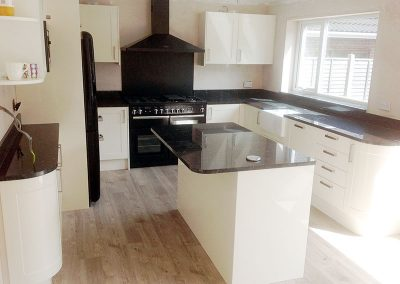 Contemporary kitchen finished with Star Galaxy granite worktops with full-height hob splash back