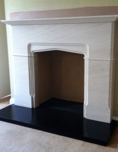 One of our original designs, this limestone surround is fitted with a slate hearth