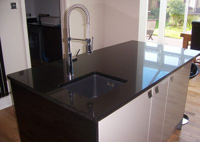 Kitchen island in Star Galaxy granite with an under mounted sink, templated, manufactured and fitted by Millstone Designs
